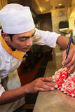 Chef doing carving Royalty Free Stock Image