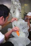 Chef doing ice carving Stock Photo