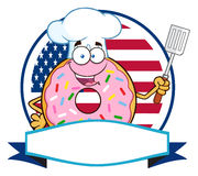 Chef Donut Cartoon Character With Sprinkles Over A Circle Blank Label In Front Of Flag Of USA Royalty Free Stock Photos