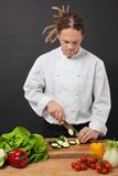 Chef with dreadlocks chopping Stock Image