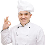 Chef dressed in white uniform showing ok sign isolated on white background Stock Image