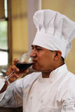 Chef Drinking Wine. Looking from side Stock Photography