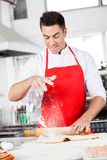 Chef Dusting Flour On Ravioli Pasta Sheet In Royalty Free Stock Images