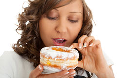 Chef eating donut Royalty Free Stock Photos