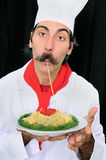 Chef Eating His Delicious Pasta Stock Photography