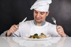 Chef eating his prepared food with cutlery Royalty Free Stock Photo