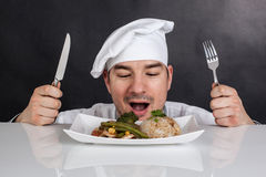 Chef eating his prepared food with cutlery Royalty Free Stock Image