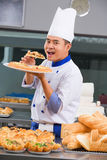 Chef eating the pizza Royalty Free Stock Photos