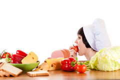 Chef eating a tomato Stock Images
