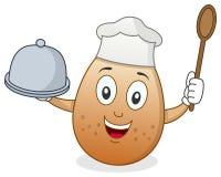 Chef Egg Character mit Behälter und Löffel Stockfotografie