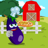 Chef eggplant with pizza pointing at viewer on a farm Royalty Free Stock Image