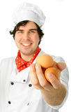 Chef with eggs Royalty Free Stock Image