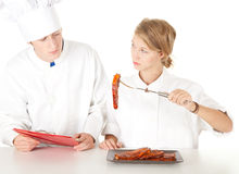 Chef examining cook Royalty Free Stock Photography