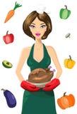 Chef féminin mignon With Roasted Turkey contre l'ensemble de légumes Images stock