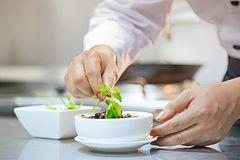 The chef in the finishing food Stock Photos