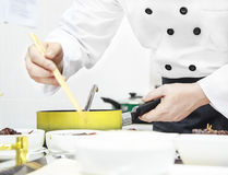 The chef in the finishing food Royalty Free Stock Images