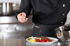 Chef finishing your plate Royalty Free Stock Photo