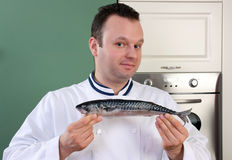 Chef and fish Royalty Free Stock Photos