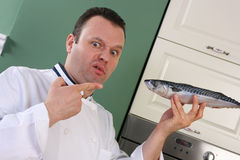 Chef and fish Royalty Free Stock Photography