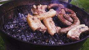 Chef is flipping meat on grill. Barbecue meat preparing on grill, close up. Mutton or pork grilling. stock video footage