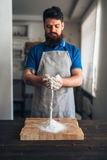 Chef with flour in hands working on cutting board Royalty Free Stock Photos