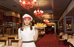 Chef with food. Young attractive female chef with dishes Stock Photos