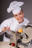 Chef at Food Slicer Royalty Free Stock Images