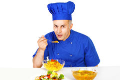 Chef food tasting. Chef tasting food, a kitchen life image Royalty Free Stock Photo