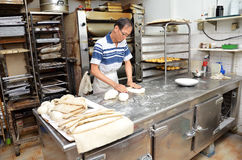 Chef forming dough in order to prepare bread Royalty Free Stock Photo