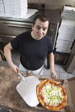 Chef with fresh take out pizza Royalty Free Stock Image