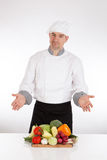 Chef and fresh vegetable Stock Images