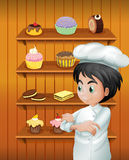 A chef in front of the baked goodies Royalty Free Stock Images