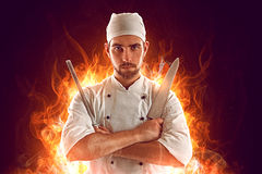 Chef. In front of a fire Royalty Free Stock Photography