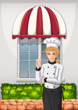 A chef in front of the restaurant Stock Images
