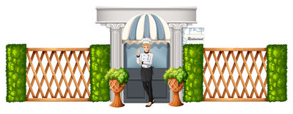 A chef in front of the restaurant with wooden fence Royalty Free Stock Image
