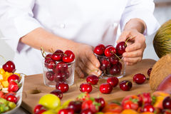 Chef with fruits Stock Images