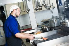 Chef Frying A Fish On Grill Royalty Free Stock Image