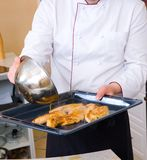Chef frying chicken fillet Royalty Free Stock Photography