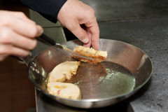 Chef is frying foie gras Stock Photo