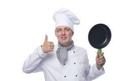 Chef with a frying pan on a white. Chef in white holding a frying pan and shows class Royalty Free Stock Photos
