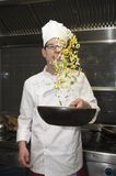 Chef frying vegetables Royalty Free Stock Photo