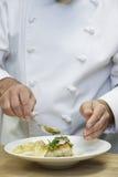 Chef Garnishing Food Stock Photo