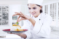 Chef garnishing food with parsley Stock Photography