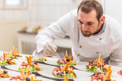 Chef garnishing his appetizer plate Royalty Free Stock Images