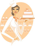 Chef girl. Young woman holding fancy wedding cake Royalty Free Stock Photos