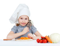 Chef girl preparing healthy food and feeding pet Stock Images