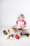 Chef girl preparing healthy food Stock Images