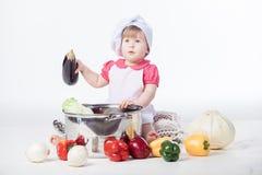 Chef girl preparing healthy food Royalty Free Stock Photo
