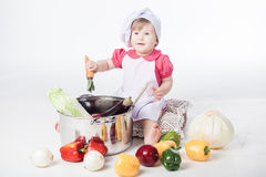 Chef girl preparing healthy food Royalty Free Stock Images