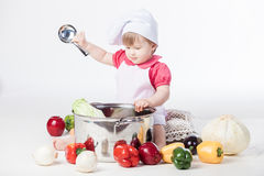 Chef girl preparing healthy food Royalty Free Stock Photos